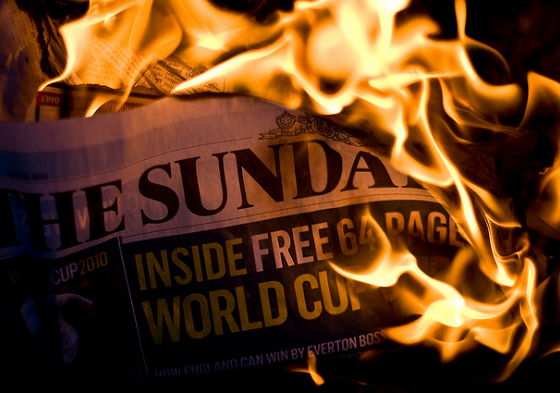 burning-newspaper